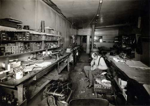 John Crabtree in his shoeshop.